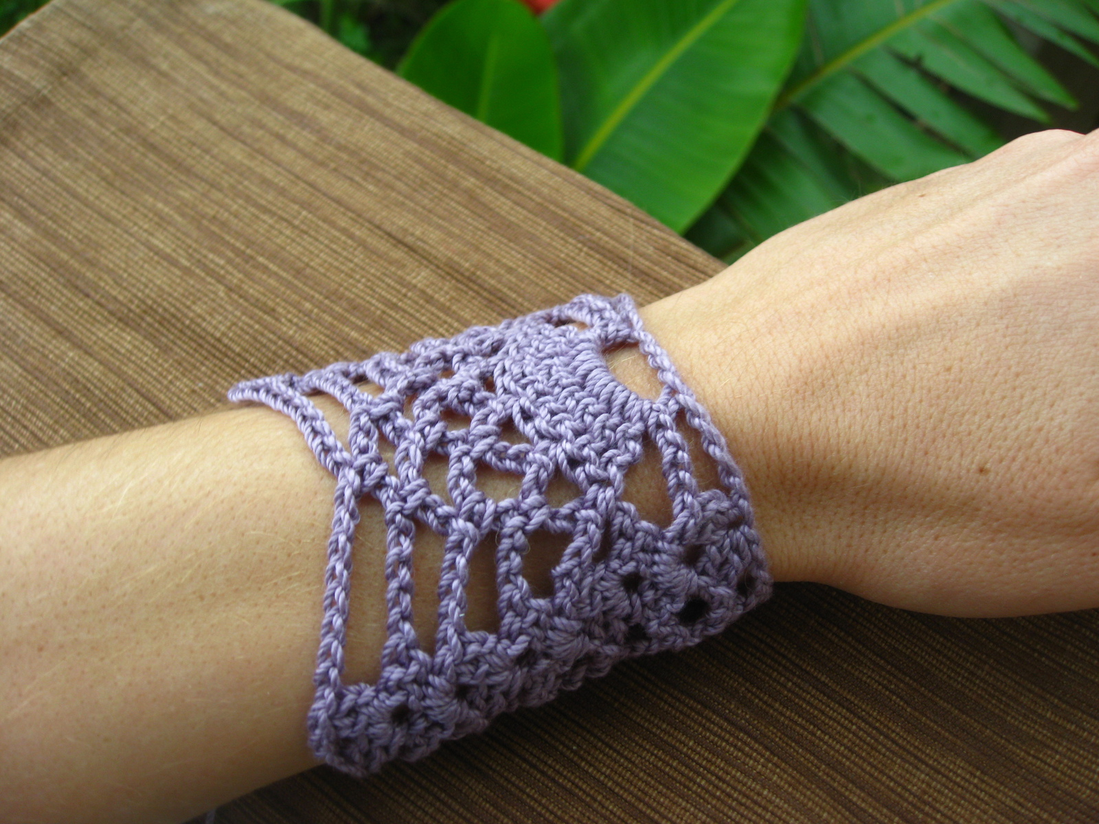 Crochet lace bracelet on a woman's wrist