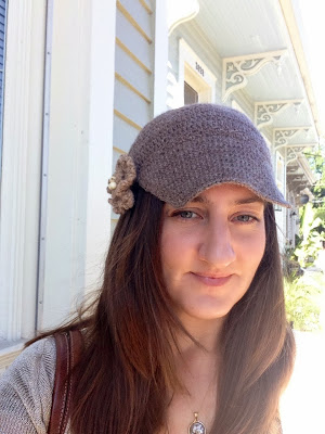 Tan crocheted cap with small stitches