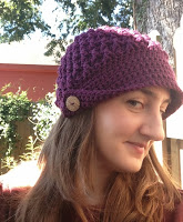 Side view of purple crocheted hat