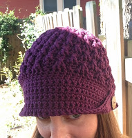 Front/top view of purple crocheted hat