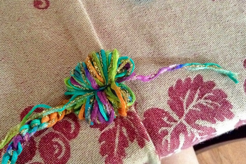 Tie yarn across yarn loops