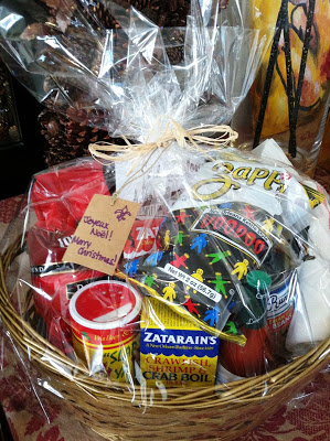 """Gift basket full of New Orleans products wrapped in cellophane"""